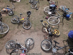 Bicycles discarded as children and dads go swimming