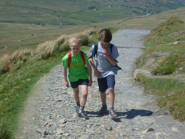 Boys in conversation while walking up Snowdon