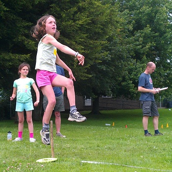 A girl throwing a ball at the mini-Olympics