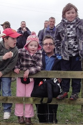 Dads and children watching the Severn Bore