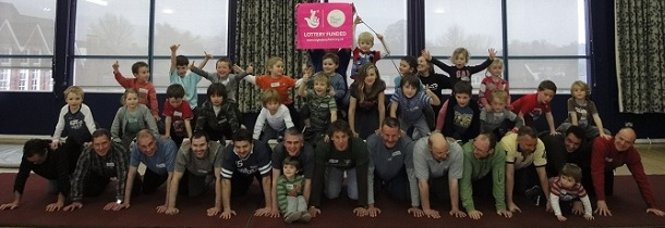 Dads and children form a human pyramid
