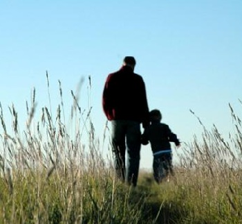 Dad walking with child