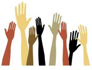 Volunteering hands raised in the air