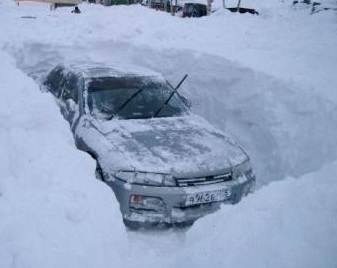 A car prevented from moving by snow