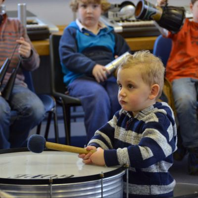 A boy tries samba drumming