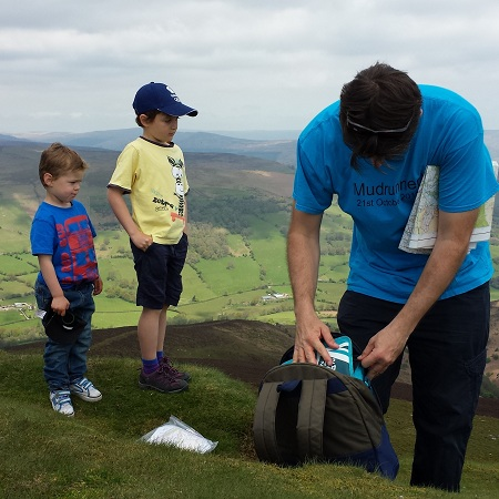 A dad and 2 children on top of Sugar Loaf
