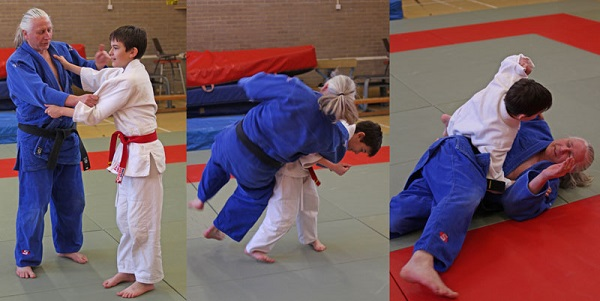 A child throws an instructor in a dojo
